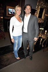 BEN BELLDEGRUN and KELLY BERGANTZ at the relaunch party of No.11 - the hotel and Private members club, 11 Cadogan Gardens, London on 4th June 2009.
