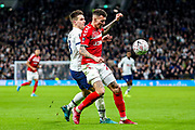 Middlesbrough midfielder Marvin Johnson (21) and Tottenham Hotspur midfielder Giovani Lo Celso (18) wrestle over the ball during the The FA Cup third round replay match between Tottenham Hotspur and Middlesbrough at Tottenham Hotspur Stadium, London, United Kingdom on 14 January 2020.