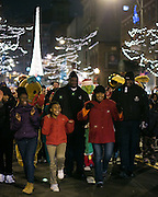Parade-goers, led by Mayor Lovely Warren, dance their way to Dr. Martin Luther King Jr. Park after the ceremonial lighting of the Liberty Pole in Rochester on Saturday, December 6, 2014.