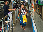 25 OCTOBER 2016 - MAE SOT, TAK, THAILAND:  A Burmese woman enter Thailand through the Thai customs and immigration post in Mae Sot on the Thai side of the border with Myanmar. The Thai-Myanmar border between Mae Sot and Myawaddy has become an important commercial crossing as democratic reforms in Myanmar (Burma) has created new economic opportunities in Thailand.   PHOTO BY JACK KURTZ