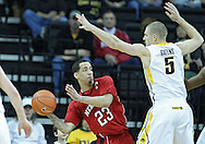 January 26, 2012: Nebraska Cornhuskers guard Bo Spencer (23) passes around Iowa Hawkeyes guard Matt Gatens (5) during the NCAA basketball game between the Nebraska Cornhuskers and the Iowa Hawkeyes at Carver-Hawkeye Arena in Iowa City, Iowa on Thursday, January 26, 2012.