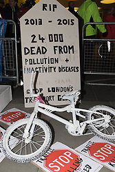 "TFL Headquarters, London. November 27th 2015. Cyclists bring traffic to a standstill as they stage their third annual ""No More Coffins Die-In and Vigil"", highlighting the need for extra provision to be made for London's increasing number of people using bicycles for commuting and leisure, placing symbolic coffins in memory of each of the 21 cyclists killed on the capital's roads, since the November 2013. //// FOR LICENCING CONTACT: paul@pauldaveycreative.co.uk TEL:+44 (0) 7966 016 296 or +44 (0) 20 8969 6875. ©2015 Paul R Davey. All rights reserved."