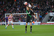 Doncaster Rovers defender Cedric Evina out jumps Stoke City forward Peter Crouch  during the The FA Cup third round match between Doncaster Rovers and Stoke City at the Keepmoat Stadium, Doncaster, England on 9 January 2016. Photo by Simon Davies.