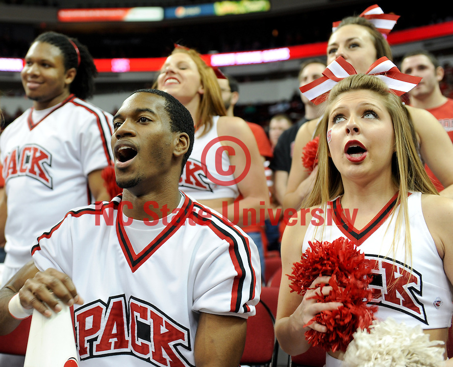 Cheerleaders get the crowd going during the NCSU basketball game against Boston College. Photo by Becky Kirkland.