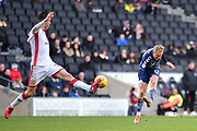 Milton Keynes Dons defender (on loan from Blackburn Rovers) Elliot Ward (15) blocks a shot from Charlton Athletic midfielder Ben Reeves (12) during the EFL Sky Bet League 1 match between Milton Keynes Dons and Charlton Athletic at stadium:mk, Milton Keynes, England on 17 February 2018. Picture by Dennis Goodwin.