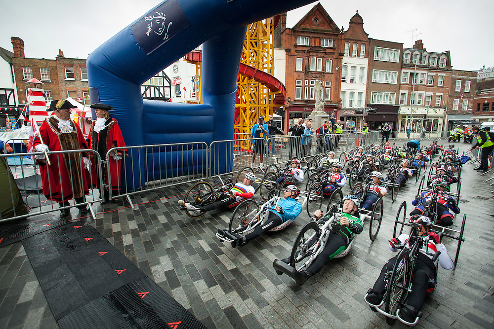 The riders take the start of the Prudential RideLondon Handcycle Classic event in the Market Place at Kingston-upon-Thames.<br /> <br /> <br /> Prudential RideLondon, the world's greatest festival of cycling, involving 70,000+ cyclists – from Olympic champions to a free family fun ride - riding in five events over closed roads in London and Surrey over the weekend of 9th and 10th August. <br /> <br /> Photo: Dillon Bryden for Prudential RideLondon<br /> <br /> See www.PrudentialRideLondon.co.uk for more.<br /> <br /> For further information: Penny Dain 07799 170433<br /> pennyd@ridelondon.co.uk
