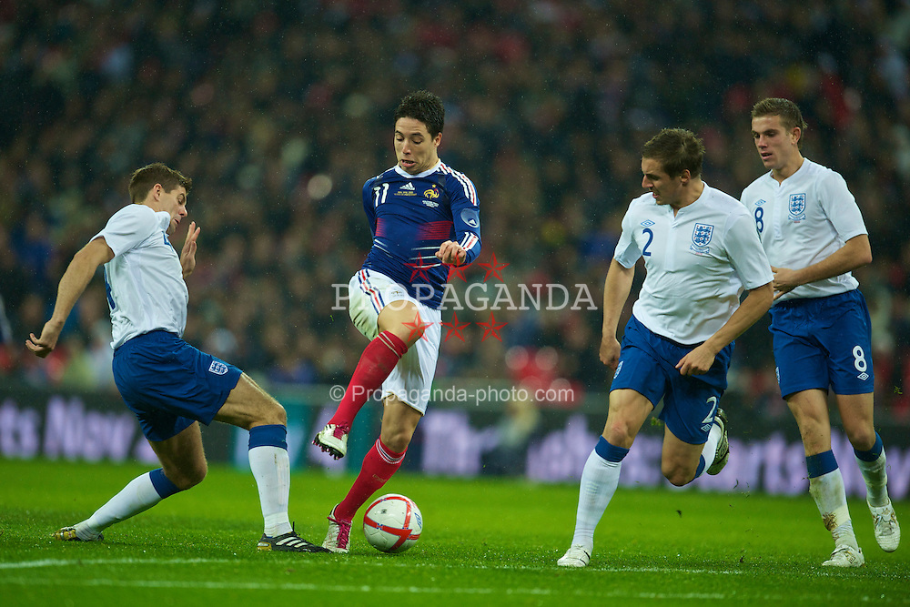 LONDON, ENGLAND - Wednesday, November 17, 2010: England's Steven Gerrard in action against France's Samir Nasri during the International Friendly match at Wembley Stadium. (Pic by: David Rawcliffe/Propaganda)