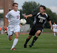 Ohio State midfielder Austin McAnena (11) drives past Binghamton defender Kevin Bunce (25) as OSU takes on Binghamton in the first half of an NCAA men's college soccer game in Columbus, Ohio on Sunday, Sept. 11, 2011, at Jesse Owens Memorial Stadium.