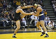 January 29, 2010: Iowa's Brent Metcalf tries to free his foot from the grip of Penn State's Frank Molinaro in the 149-pound bout at Carver-Hawkeye Arena in Iowa City, Iowa on January 29, 2010. Metcalf pinned Molinaro in 3:56 and Iowa defeated Penn State 29-6.