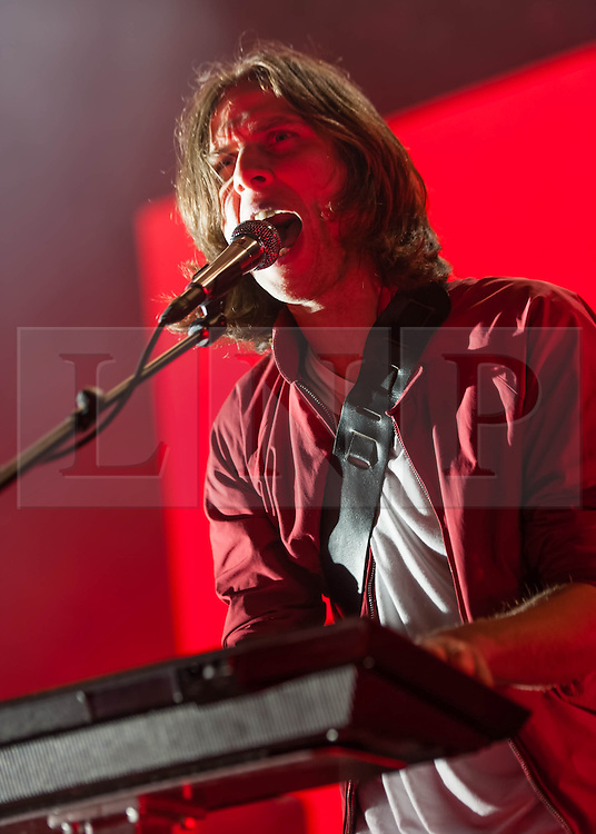 © Licensed to London News Pictures. 12/02/2014. London, UK.   Phoenix performing live at Brixton Academy.  In this picture - Deck D'Arcy. Phoenix is a french alternative rock band comprising of members Thomas Mars (vocals), Deck D'Arcy (Bass,Keyboards), Laurent Brancowitz (guitar, keyboards), Christian Mazzalai (guitar).  Photo credit : Richard Isaac/LNP