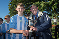 Grenville Dawson secretary of the Dundee Schools Football Association presents the Logie Cup to Grove captain Leon Winterton - Grove (blue and white) v. Harris (red) in the U13 Logie Cup Final  (sponsored by DFCSS) at Whitton Park, Dundee, Photo: David Young<br /> <br />  - &copy; David Young - www.davidyoungphoto.co.uk - email: davidyoungphoto@gmail.com