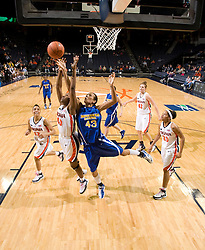 Morehead St. forward Brittany Pittman (43) and Virginia guard Enonge Stovall (40) battle for a rebound.  The Virginia Cavaliers women's basketball team defeated the Morehead State Eagles 88-43 at the John Paul Jones Arena in Charlottesville, VA on February 4, 2008.