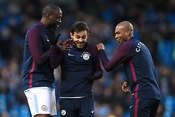 3rd December 2017 - Premier League - Manchester City v West Ham United - Yaya Toure of Man City (L) and Fernandinho of Man City (R) tease teammate Bernardo Silva during the warm-up - Photo: Simon Stacpoole / Offside.