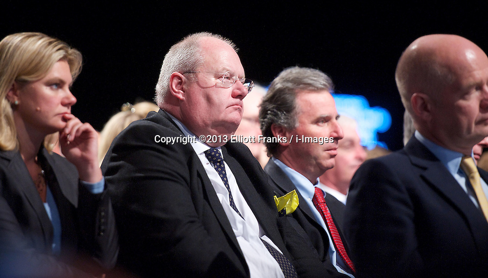 David Cameron Keynote Speech. <br /> Eric Pickles watching speech. <br /> Prime Minister David Cameron during his keynote speech to the Conservative Party Conference, Manchester, United Kingdom. Wednesday, 2nd October 2013. Picture by Elliott Franks / i-Images