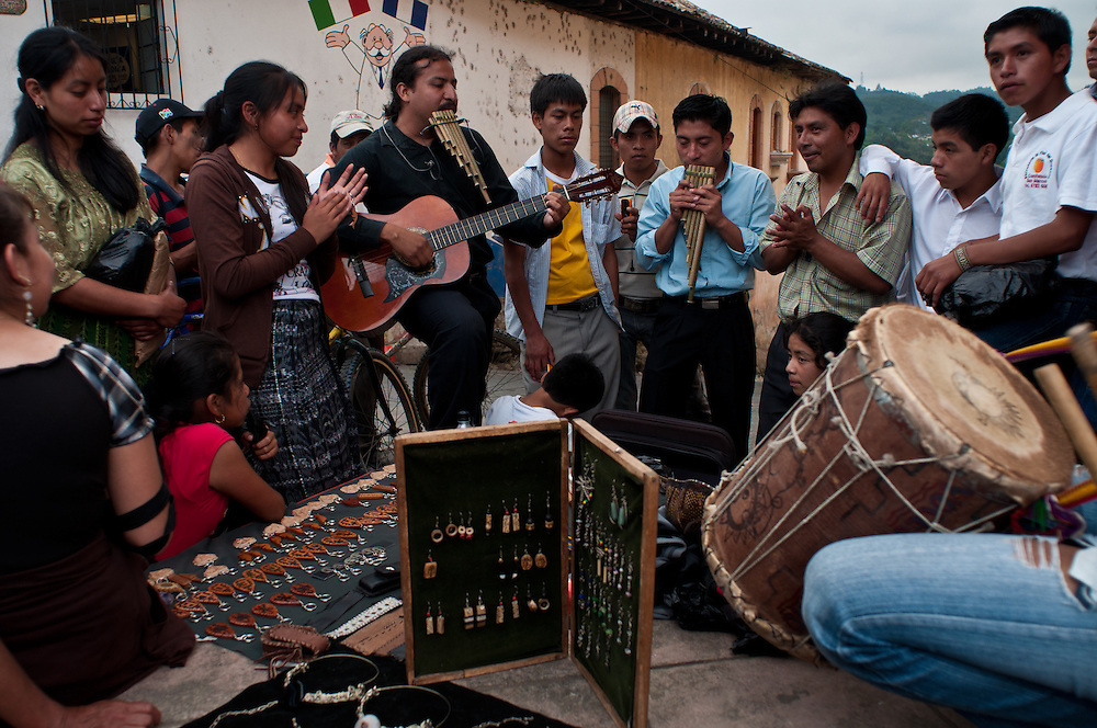 "Guatemalans break out in song on a street corner in Cobán during ""La Fiesta Nacional Indígena de Guatemala"", also known as Festival Folklórico, celebrated annually during July."