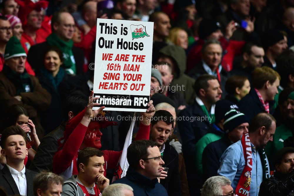 A Welsh fan holds up a sign.  RBS Six nations 2015 championship, Wales v Ireland  at the Millennium stadium in Cardiff, South Wales on Saturday 14th March 2015<br /> pic by Andrew Orchard, Andrew Orchard sports photography.
