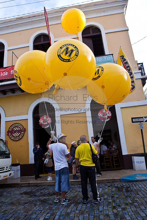 People gather with giant balloons in Old San Juan, Puerto Rico