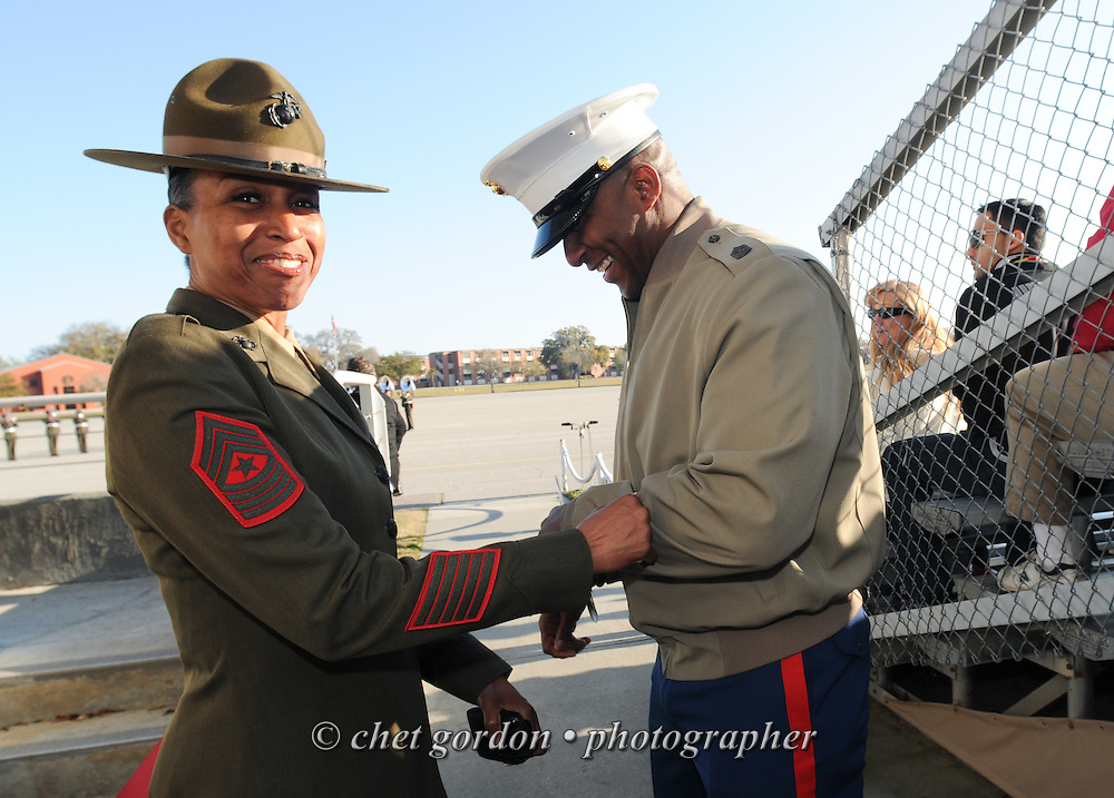 A female and male Marine Corps Sgt. Majors share a laugh together prior to a graduation ceremony at the Marine Corps Recruit Depot (MCRD) in Parris Island, SC on Friday, March 15, 2013.