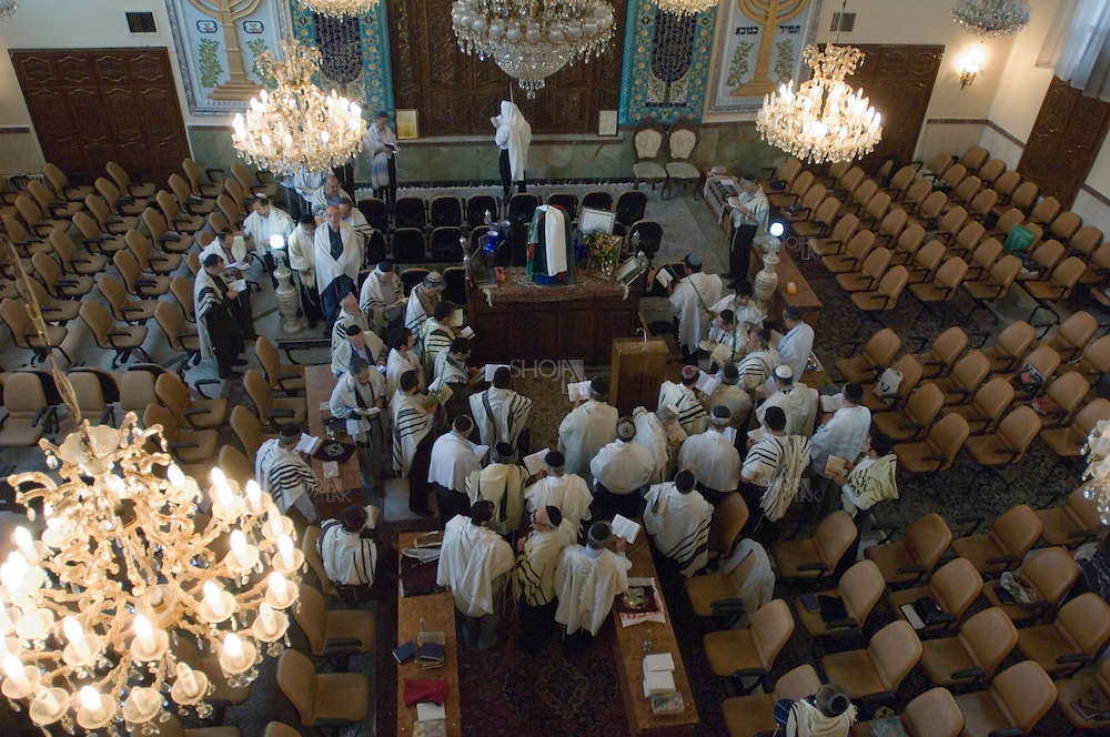 Tehran, Iran. October 1, 2007- Men pray during an early morning service at the Yousefabad synagogue, for the festival of Rejoicing.