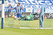 Wigan Athletic Forward, Will Grigg  is brought down in the area by Bury Goalkeeper, Ian Lawlor during the Sky Bet League 1 match between Wigan Athletic and Bury at the DW Stadium, Wigan, England on 27 February 2016. Photo by Mark Pollitt.