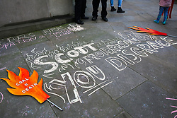 © Licensed to London News Pictures. 10/01/2020. London, UK. Messages are written on the pavement outside High Commission of Australia in central London as <br /> hundreds of Australians and campaigners from Extinction Rebellion climate change movement group protest against the Australian government's failure to respond to the bush fires and address the climate and ecological crisis. Photo credit: Dinendra Haria/LNP