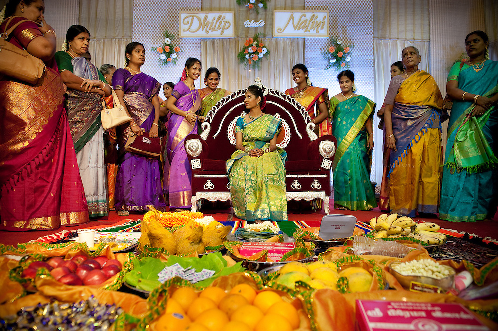 The bride with all her gifts, surrounded by women from the bridegroom's family.