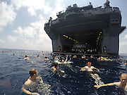 GULF OF ADEN (April 18, 2015) <br /> <br /> USS Iwo Jima holds in a swim call<br /> <br /> Sailors and Marines aboard the amphibious assault ship USS Iwo Jima (LHD 7) participate in a swim call. Iwo Jima is the flagship for the Amphibious Ready Group and, with the embarked 24th Marine Expeditionary Unit (24th MEU), provides a versatile, sea-based expeditionary force that can be tailored to a variety of missions in the U.S. 5th Fleet area of operations. <br /> ©Megan Anuci/US Navy/Exclusivepix Media