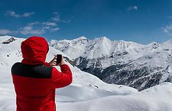 THEMENBILD - ein Mann fotografiert mit seinem Smartphone das tief winterliche Bergpanorama. Die Grossglockner Hochalpenstrasse verbindet die beiden Bundeslaender Salzburg und Kaernten mit einer Laenge von 48 Kilometer und ist als Erlebnisstrasse vorrangig von touristischer Bedeutung, aufgenommen am 2. Mai 2017, Fusch a. d. Glocknerstrasse, Oesterreich // A man photographed the deep-wintry mountain panorama with his smartphone. The Grossglockner High Alpine Road connects the two provinces of Salzburg and Carinthia with a length of 48 km and is as an adventure road priority of tourist interest at Fusch a. d. Glocknerstrasse, Austria on 2017/05/02. EXPA Pictures © 2017, PhotoCredit: EXPA/ JFK
