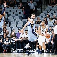 04 April 2017: San Antonio Spurs guard Tony Parker (9) looks to pass the ball over Memphis Grizzlies center Marc Gasol (33) and Memphis Grizzlies guard Mike Conley (11) during the San Antonio Spurs 95-89 OT victory over the Memphis Grizzlies, at the AT&T Center, San Antonio, Texas, USA.