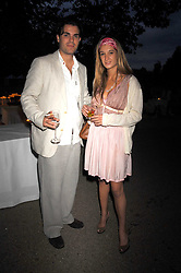 BARON DIETER VON SCHNEIDER and RACHELLE LUNNON at a Summer BBQ for Kitts nightclub hosted by Chalie Gilkes and Duncan Stirling at the Hurlingham Club, London on 31st August 2007.<br />