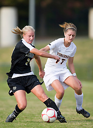 Wake Forest Demon Decons Midfielder Camelyn Dillon (7) protects the ball from Virginia Cavaliers midfielder/forward Sinead Farrelly (17).  The Wake Forest Demon Deacons defeated the #11 ranked Virginia Cavaliers 1-0 NCAA women's soccer at Klockner Stadium on the Grounds of the University of Virginia in Charlottesville, VA on November 2, 2008.