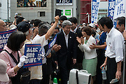 Journalist Shuntaro Torigoe, a major candidate for Tokyo greets people as he kicks off his campaign for the July 31 Tokyo gubernatorial election in front of the station of Kita-Senju, Japan on Thursday, July 16 2016. <br /> Torigoe has the joint backing of opposition parties including the Democratic Party and the Japanese Communist Party in the July 31 election. 16/07/2016-TOKYO, JAPAN