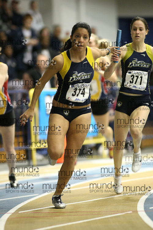 Windsor, Ontario ---13/03/09--- Nicole Sassine of  the University of Windsor competes in the 4 X 200 meter relay at the CIS track and field championships in Windsor, Ontario, March 13, 2009..GEOFF ROBINS Mundo Sport Images
