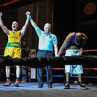 Golden Gloves- Jimmy Smith of Vermont reacts to winning , center Ref Mike Ryan and opponent Michael Andrade in 152 lb. bout. The Sun photo by Tory Germann