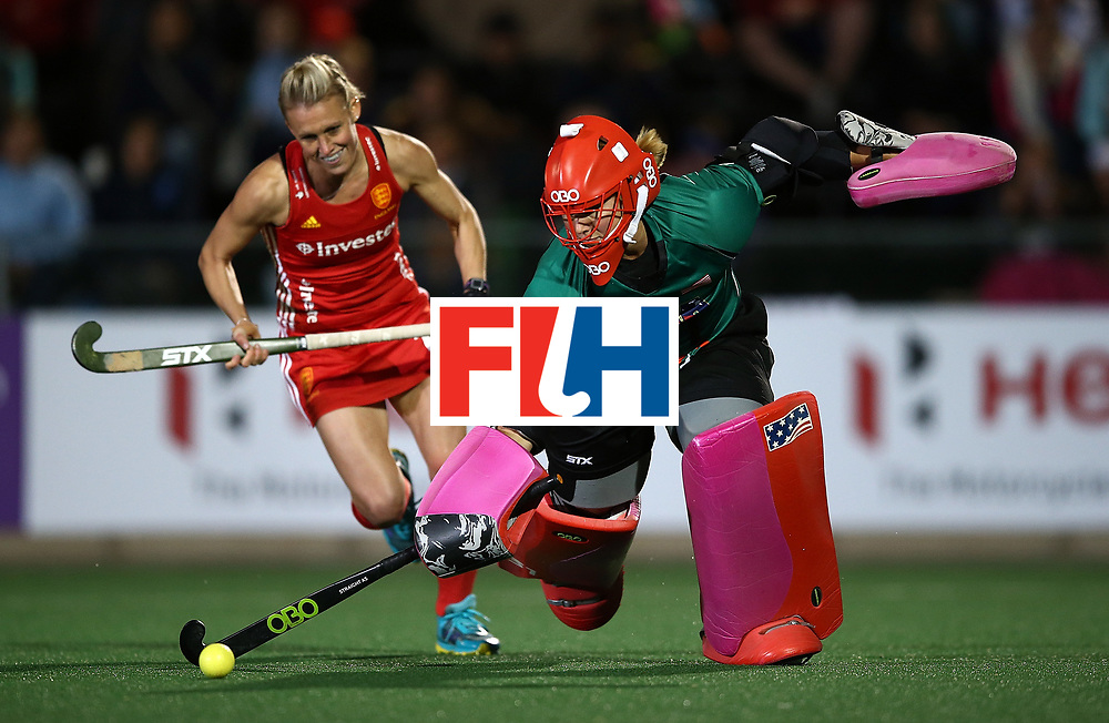 JOHANNESBURG, SOUTH AFRICA - JULY 20:  Jackie Briggs, goalkeeper of United States of America clears the ball from Alex Danson of England in the shoot out for a win during day 7 of the FIH Hockey World League Women's Semi Finals semi final match between England and United Staes of America at Wits University on July 20, 2017 in Johannesburg, South Africa.  (Photo by Jan Kruger/Getty Images for FIH)