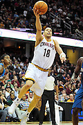 April 13, 2011; Cleveland, OH, USA; Cleveland Cavaliers shooting guard Anthony Parker (18) lays in a basket during the second quarter against the Washington Wizards at Quicken Loans Arena. Mandatory Credit: Jason Miller-US PRESSWIRE
