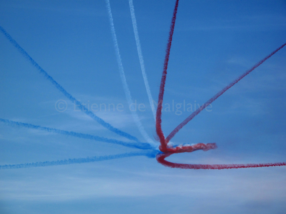 "Coloured smoke trails from French air forces aerobatic team ""La Patrouille de France"" during an airshow rehearsal over the scenic cliff of Etretat, a Normandy coastal town in France. 23 September 2011."