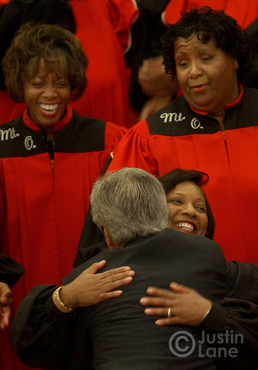 United States Senator and Democratic Candidate for President John Kerry (C) hugs a member of the choir at Mt. Olivet Baptist Church in Columbus, OH where attended mass on Sunday, 17 October 2004...EPA/JUSTIN LANE