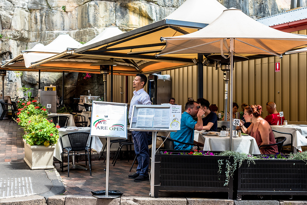 Sydney, Australia -- February 18, 2018. Patrons dining at an outdoor reastaurant in The Rocks area of Sydney on a Sunday afternoon. Editorial use only.