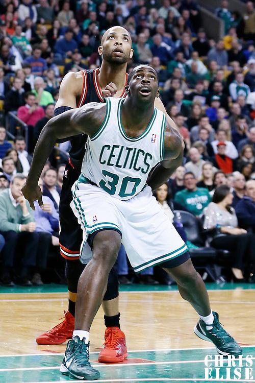 18 January 2013: Boston Celtics power forward Brandon Bass (30) vies for the rebound with Chicago Bulls power forward Taj Gibson (22) during the Chicago Bulls 100-99 overtime victory over the Boston Celtics at the TD Garden, Boston, Massachusetts, USA.