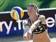 STARE JABLONKI POLAND - July 3: Katrin Holtwick /1/ of Germany in action during Day 3 of the FIVB Beach Volleyball World Championships on July 3, 2013 in Stare Jablonki Poland.  (Photo by Piotr Hawalej)