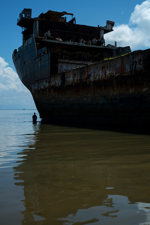 Dar es Salaam, Tanzania - 01.12.17  - An abandoned vessel rusts away and leaks oil into the Indian Ocean in Dar es Salaam, Tanzania on Decmeber 2, 2017.