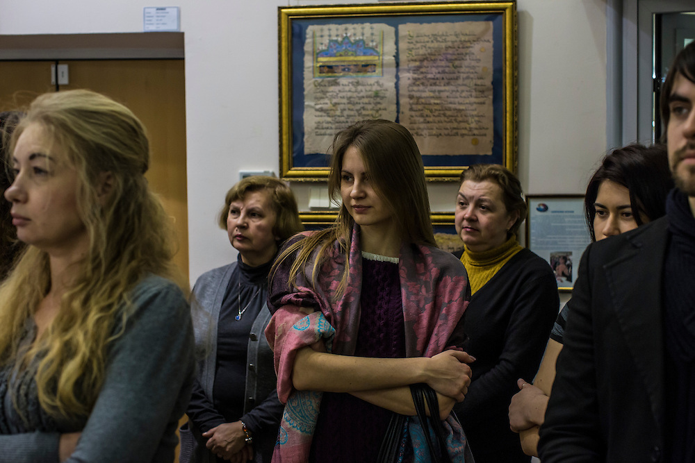 DONETSK, UKRAINE - JANUARY 29, 2015: People attend the opening of an art exhibition entitled Hope, Belief, and Love in Donetsk, Ukraine. The exhibit showed the work of young local painters. CREDIT: Brendan Hoffman for The New York Times