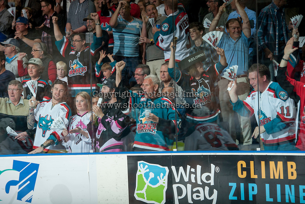 KELOWNA, CANADA - MAY 11: Fans celebrate a goal for the Kelowna Rockets against the Brandon Wheat Kings on May 11, 2015 during game 3 of the WHL final series at Prospera Place in Kelowna, British Columbia, Canada.  (Photo by Marissa Baecker/Shoot the Breeze)  *** Local Caption *** fans