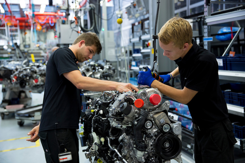 Mercedes-AMG engine production factory in Affalterbach, Germany - trainee engineer is supervised hand-building a complete M157 5.5L V8 biturbo engine