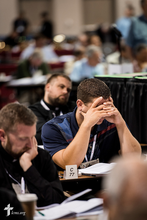 A delegate rests his face in his hands on Wednesday, July 13, 2016, at the 66th Regular Convention of The Lutheran Church–Missouri Synod, in Milwaukee. LCMS/Michael Schuermann