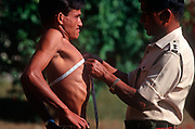 A young Nepali boy is measured for lung capacity during a recruitment test for the Gurkha Regiment - part of a tough endurance series to find physically perfect specimens for British army infantry training, on 16th January 1997, in Pokhara, Nepal. 60,000 boys aged between 17-22 (or 25 for those educated enough to become clerks or communications specialists) report to designated recruiting stations in the hills each November, most living from altitudes ranging from 4,000-12,000 feet. After initial selection, 7,000 are accepted for further tests from which 700 are sent down here to Pokhara in the shadow of the Himalayas. Only 160 of the best boys succeed in the journey to the UK. Nepal has been supplying youths for the British army since the Indian Mutiny of 1857. (Photo by Richard Baker / In Pictures via Getty Images)