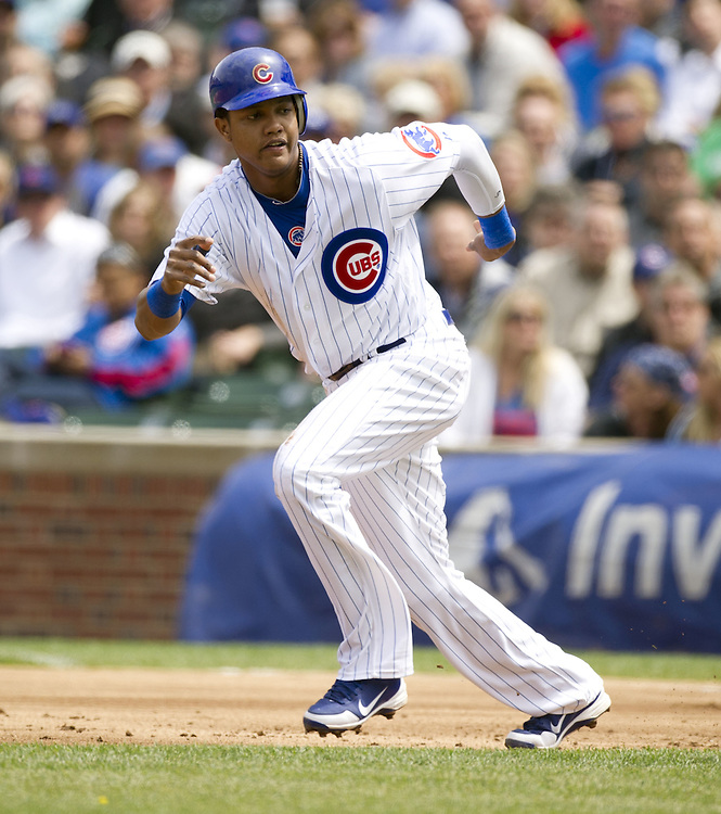 CHICAGO - MAY  04:  Starlin Castro #13 of the Chicago Cubs runs the bases against the Los Angeles Dodgers on May 4, 2012 at Wrigley Field in Chicago, Illinois.  The Cubs defeated the Dodgers 5-4.  (Photo by Ron Vesely)   Subject:  Starlin Castro