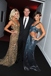 Left to right, MOLLIE KING, WAYNE BRIDGE and FRANKIE SANDFORD at a party hosted by Roberto Cavalli to celebrate his new Boutique's opening at 22 Sloane Street, London followed by a party at Battersea Power Station, London SW8 on 17th September 2011.