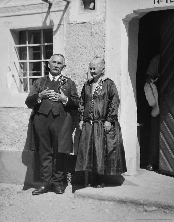 Elderly couple in traditional costume, Molln, Austria, c1935